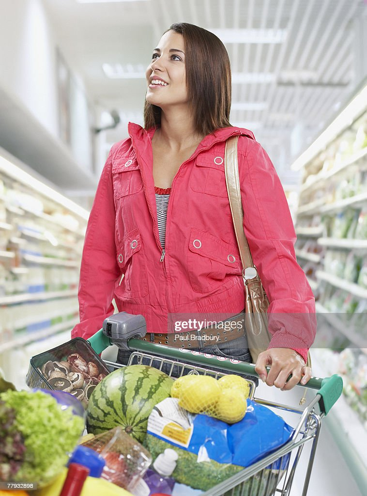 Woman grocery shopping : Stock Photo
