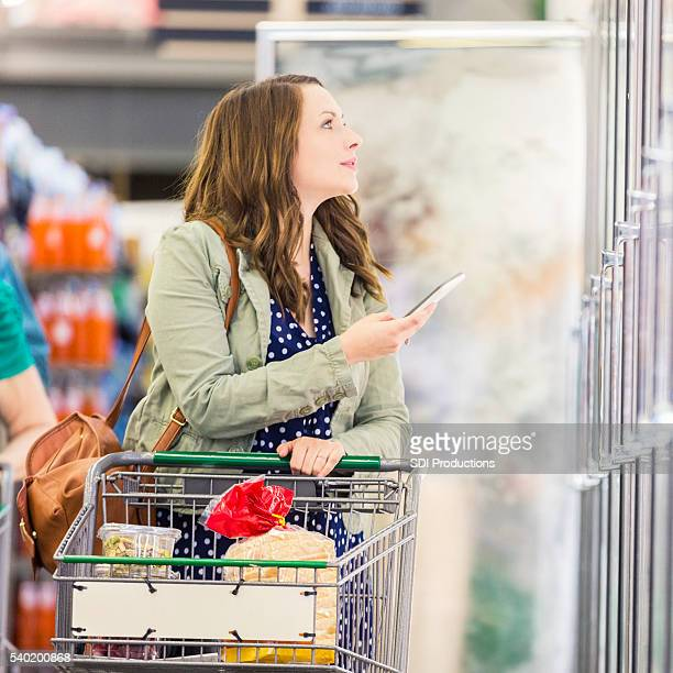 Woman grocery shopping with smart phone