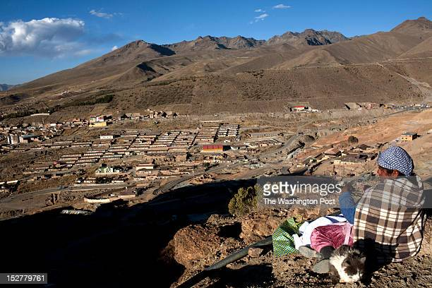 A woman guards the mouth of a mine preventing thieves from stealing tools or minerals Potosi Bolivia 2012