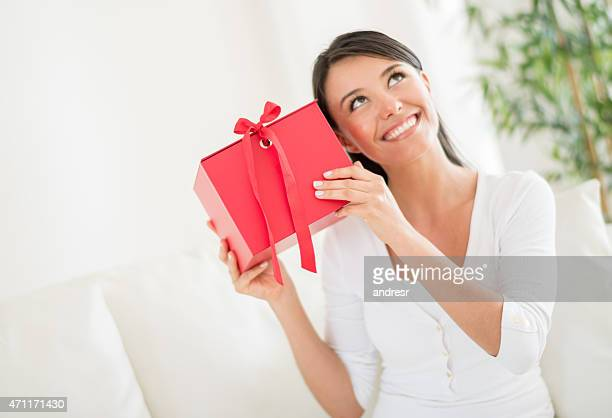 Woman guessing what she got for a gift