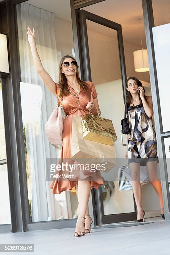 Woman hailing a cab : Stock Photo