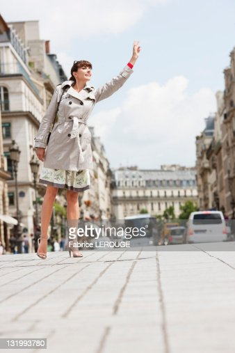 woman hailing a taxi paris iledefrance france stock photo getty images. Black Bedroom Furniture Sets. Home Design Ideas