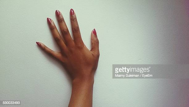 Woman Hand Against Wall