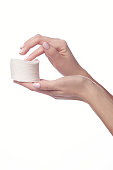 Woman hand and nail varnish remover, acetone isolated on white, clipping path included