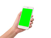 woman hand holding a modern mobile smart phone with blank green screen isolated on white background with clipping path. blank green screen to put your own message