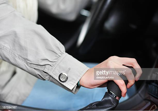 Woman hand on gearshift in car