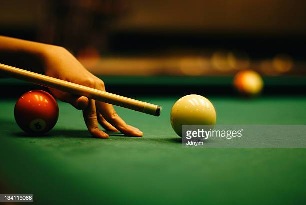 Woman hand playing pool