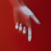 woman hand showing direction down by finger in red blood water, cover for art in horror genre, detective novel, creative idea