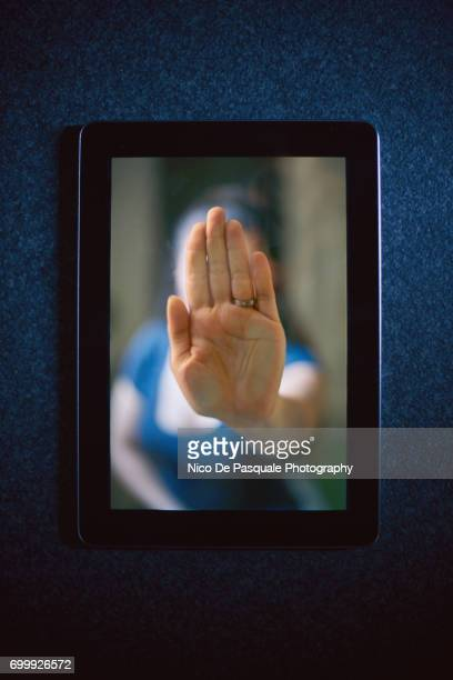 Woman hand squashed on digital tablet