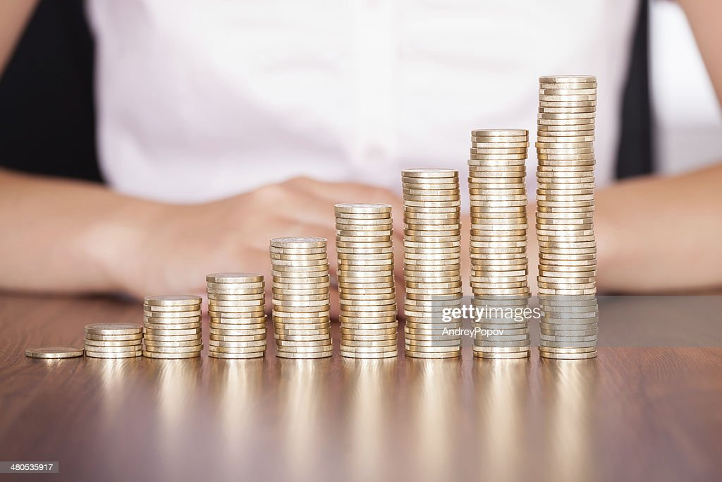 Woman Hand Stacking Gold Coin : Stock Photo
