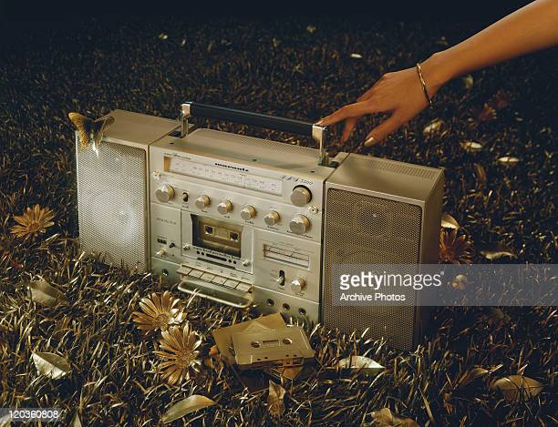 Woman hand touching boom box