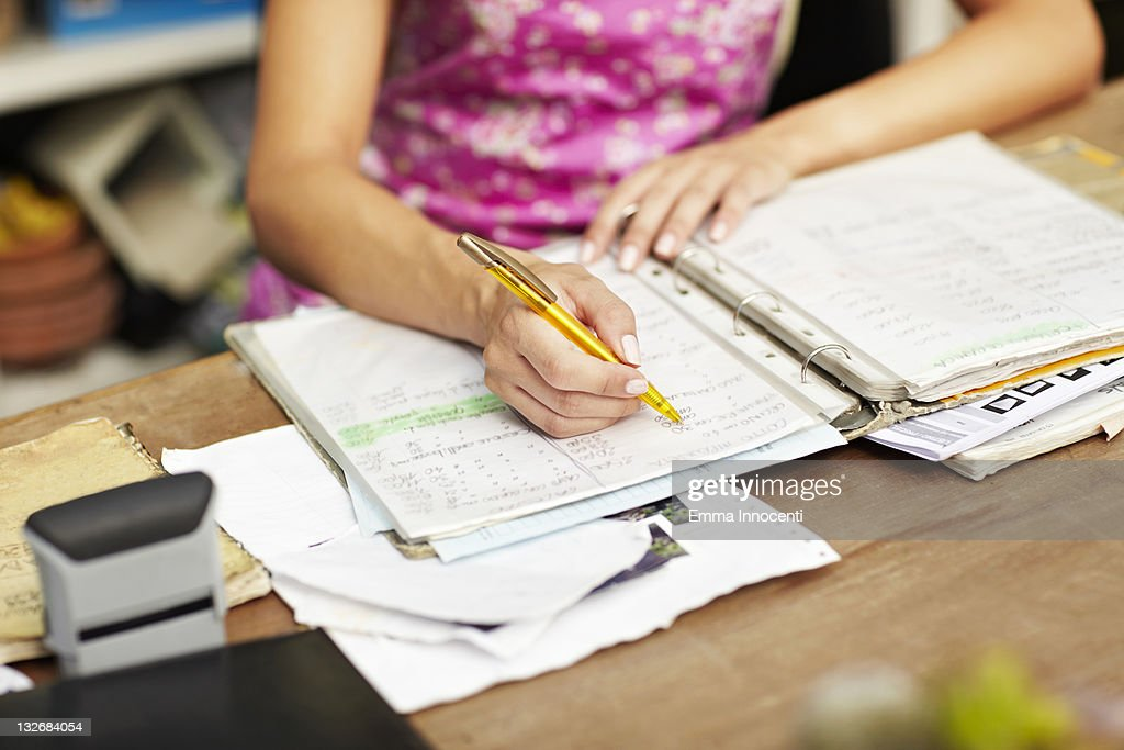 woman, hand, writing, desk, order book : Stock Photo
