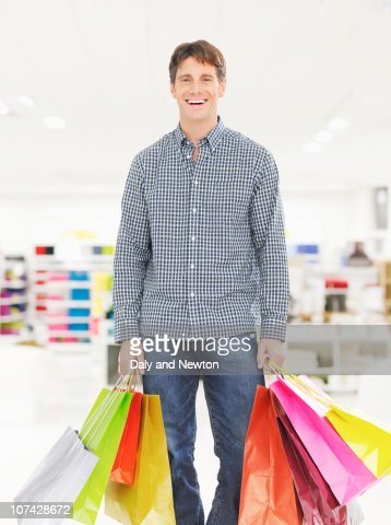 Woman handing cashier her credit card in store : Stock Photo