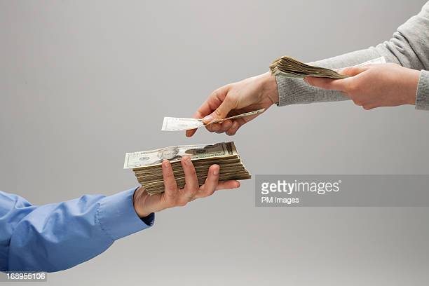 Woman handing man money