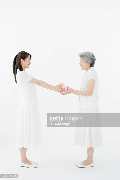 Woman handing present to mother