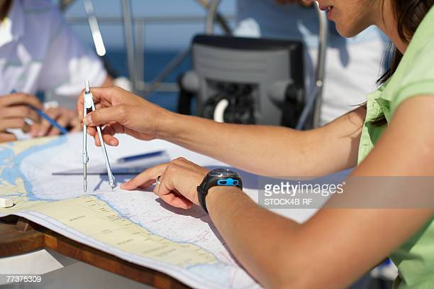 Woman handling a sea chart