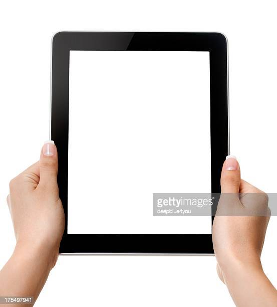 Woman hands holding a touchscreen on white