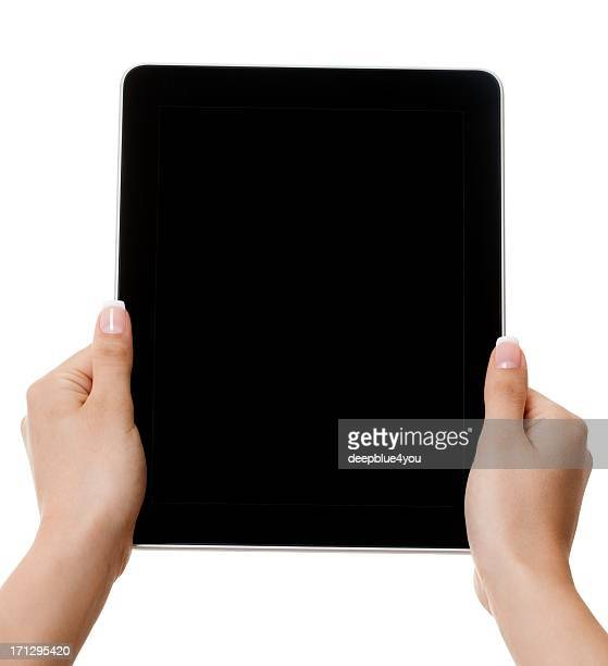 Woman hands holding black tablet pc with black screen isolated