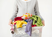 Woman hands holding laundry basket