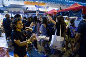 A woman hands out food as prodemocracy protestors gather in the Admiralty district of Hong Kong on October 1 2014 Hong Kong has been plunged into the...