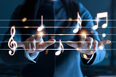 Woman hands playing music notes on dark background, music concept