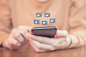 Woman hands using mobile smartphone with icon social media and social network.