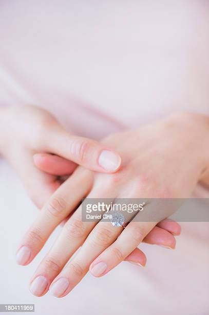 Woman hands with engagement ring