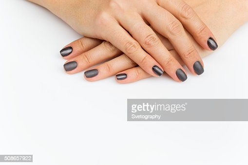 Woman hands with grey nails : Stock Photo