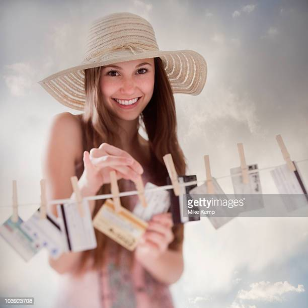 Woman hanging credit cards on clothesline