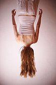 Woman hanging upside down