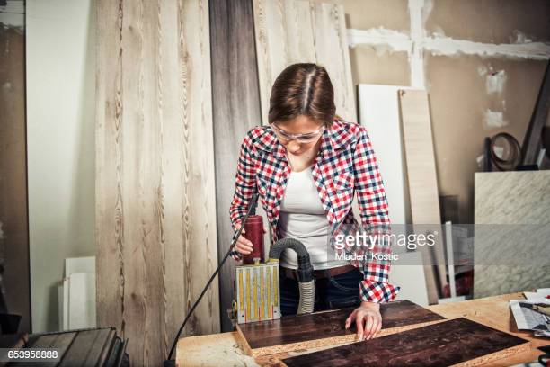 Woman hard working in a carpentry workshop