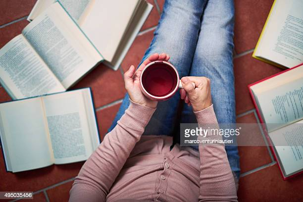 Woman has a break from reading