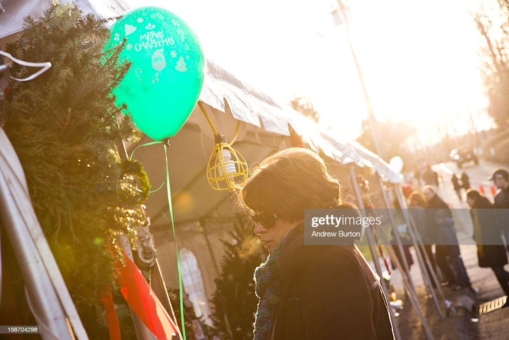 A woman has a moment of silence at a memorial for those killed in the school shooting at Sandy Hook Elementary School on December 24, 2012 in Newtown, Connecticut. Donations and letters are pouring in from across the country as the town tries to recover from the massacre.