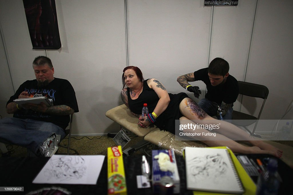 A woman has a tattoo applied during The Tattoo Jam Festival on August 5, 2011 in Doncaster, England. The Tattoo Jam Festival is Britain's biggest gathering of tattoo professionals and skin art devotees. The event hosts over 300 artists working in the exhibition hall of Doncaster Racecourse revealing their latest designs and techniques.