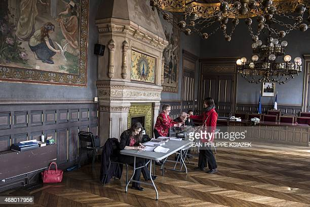A woman has her electoral card checked during the second round of the French departemental elections in Valence eastern France on March 29 2015 AFP...