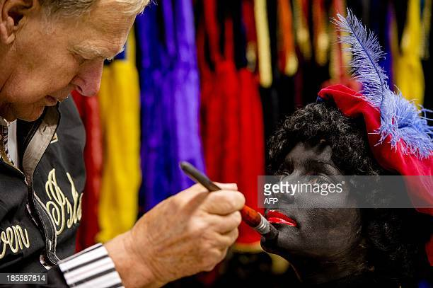 A woman has her face painted to become Zwarte Piet in Soest on October 22 2013 Zwarte Piet is as part of the Dutch tradition the companion of...