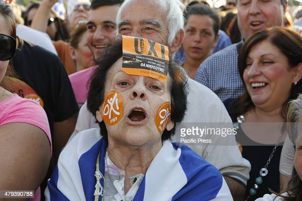 SQUARE ATHENS ATTICA GREECE A woman has put 'Oxi' stickers all over her face and shouts slogans at the final 'No' vote rally in Athens Tens of...