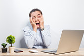 Woman has shock when she look at laptop