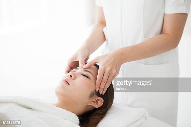Woman having a forehead massaged