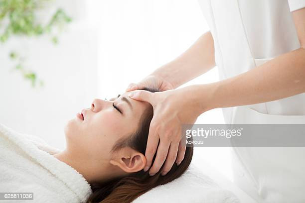 Woman having a head massage for his health