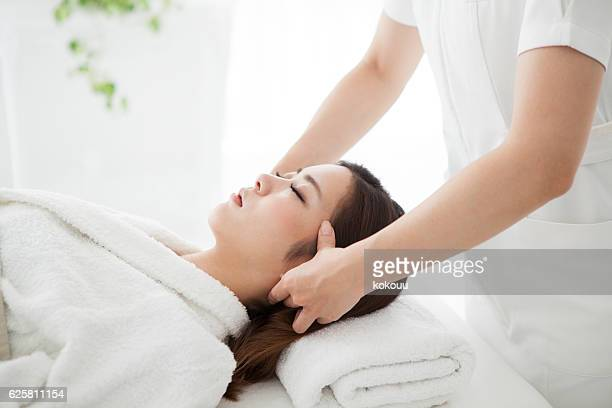 Woman having a head massage for treatment