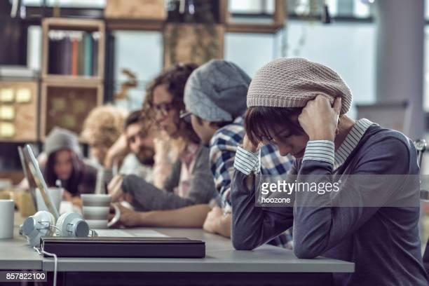 Woman Having a Headache in an Office