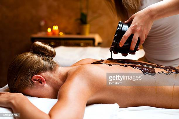 Woman having a massage with hot chocolate