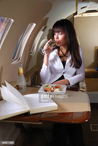 A woman having a meal on a private jet