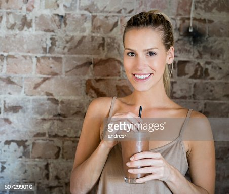 Woman having a milkshake