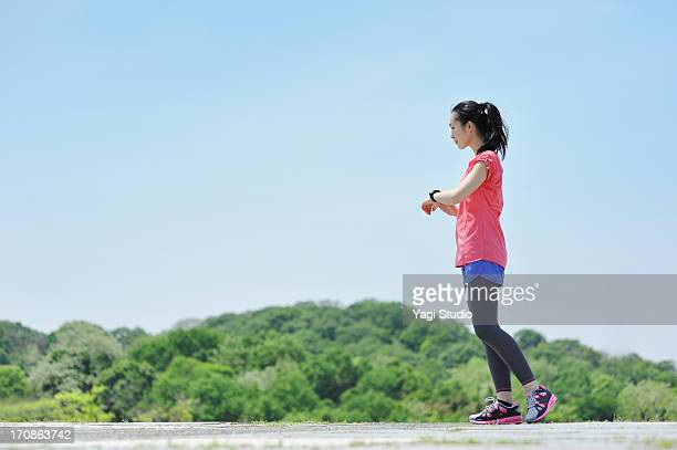 Woman having a warm-up for a run.