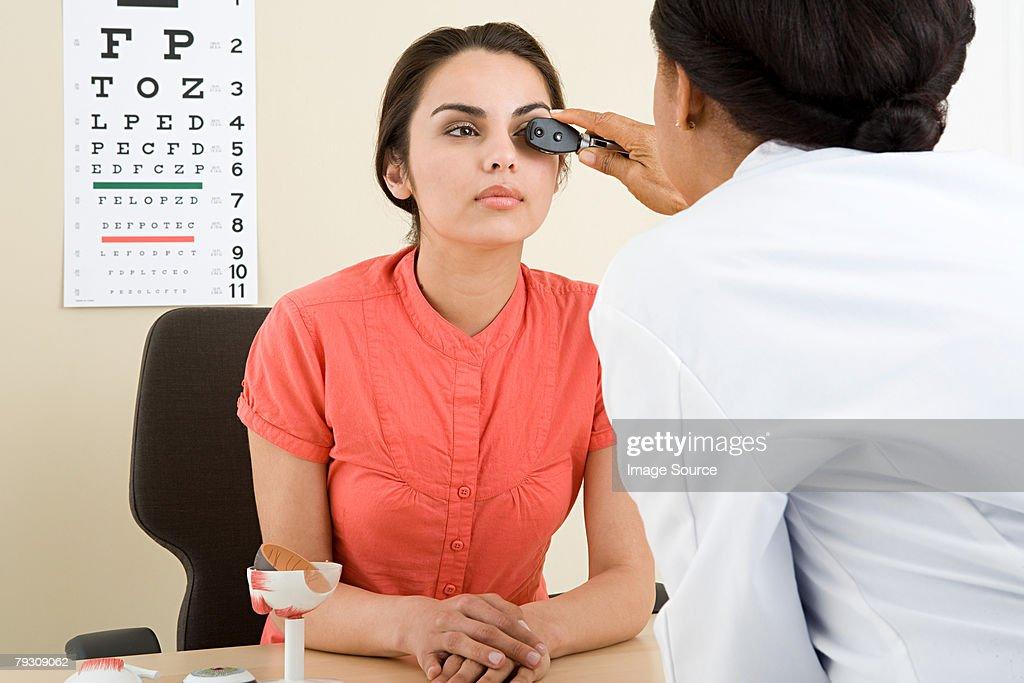 A woman having an eye test