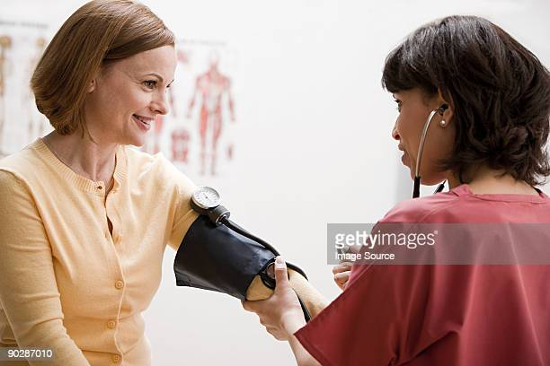 Woman having blood pressure tested