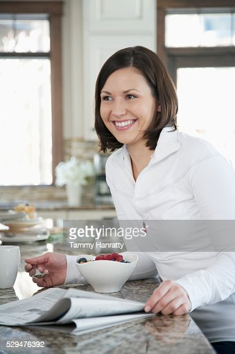 Woman having breakfast : Stock Photo