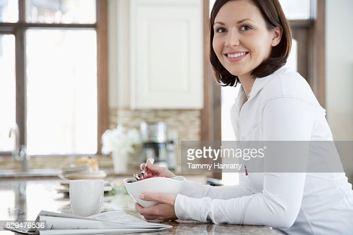 Woman having breakfast : Bildbanksbilder